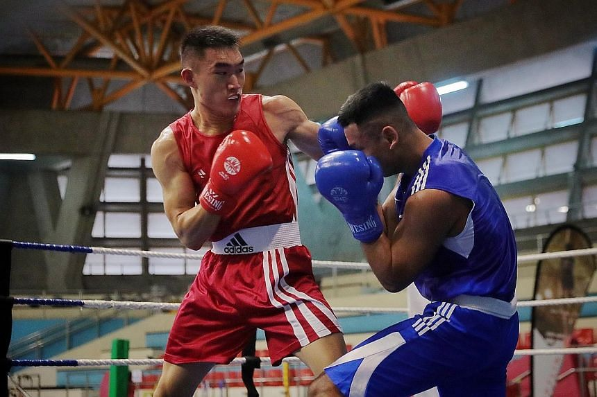 Left: Still fresh after winning his bout, Velvan Tan advises second brother Velco during the latter's fight. Above: Velco Tan getting the upper hand against Danish Husli.