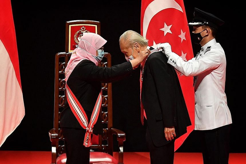 President Halimah Yacob presenting the Distinguished Service Order to Professor Wang Gungwu at the 2020 National Day Awards ceremony held at the Institute of Technical Education College Central yesterday. Prof Wang was recognised for his instrumental