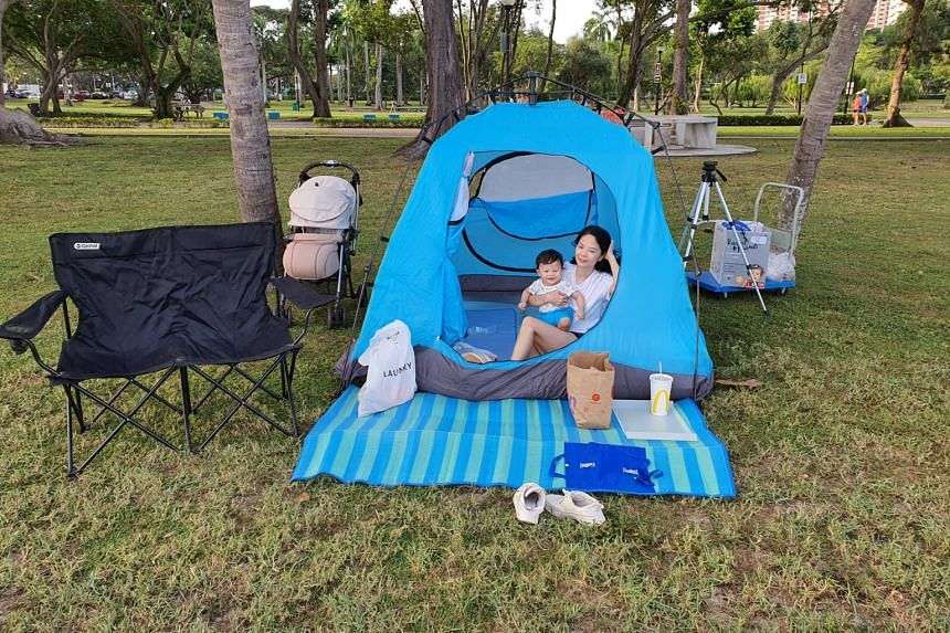 Ms Dixie Chin and her 15-month-old son during a camping trip at East Coast Park with her husband Alvin Chin (not pictured).