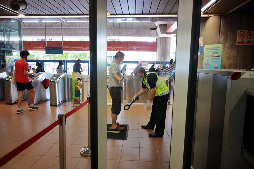 Enhanced security screening conducted at Bukit Gombak MRT station on April 1, 2021.
