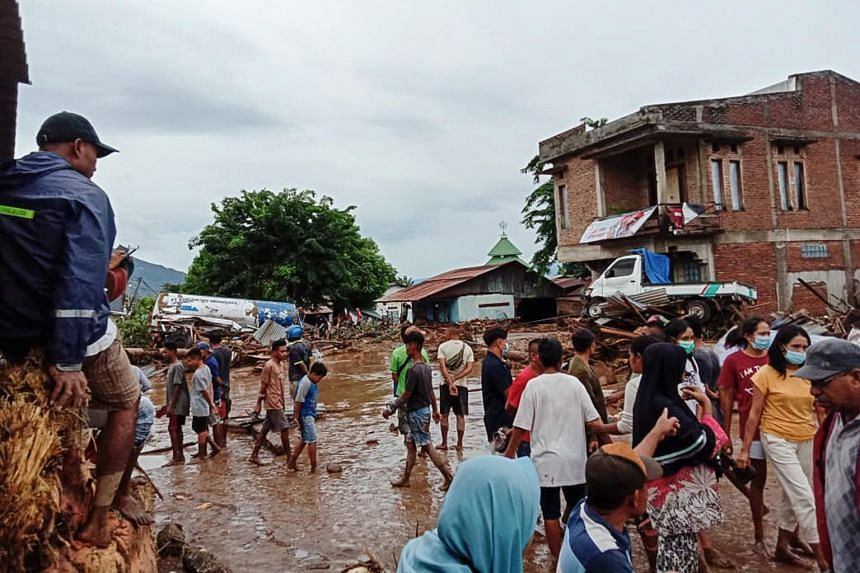 People gathering after a flash flood hit their village in Adonara, East Flores, Indonesia, on April 4, 2021.