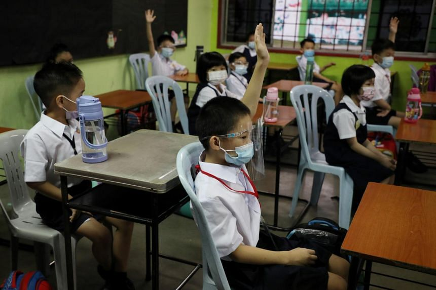 Students wear protective masks during a class at a primary school in Kuala Lumpur on March 1, 2021.
