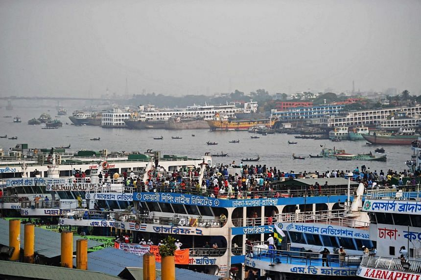 People cram on ferries to travel back to their homes in Dhaka on April 4, 2021.