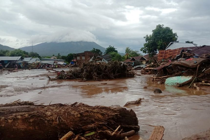 Damaged houses are seen at an area affected by flash floods after heavy rains in East Flores, Indonesia, on April 4, 2021.