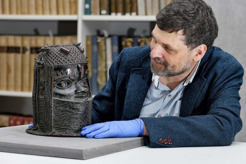 Mr Neil Curtis, head of museums and special collections at the University of Aberdeen, with a bronze sculpture depicting a king of Benin acquired at auction by the Scottish university in 1957.
