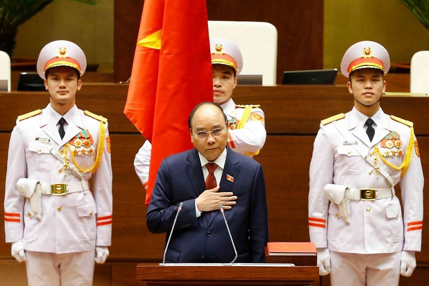 Vietnam's newly elected President Nguyen Xuan Phuc taking oath during the National Assembly's spring session in Hanoi, on April 5, 2021.