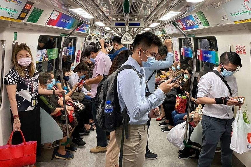 Commuters on board Outram Park MRT, which is heading towards the city, on April 5, 2021.