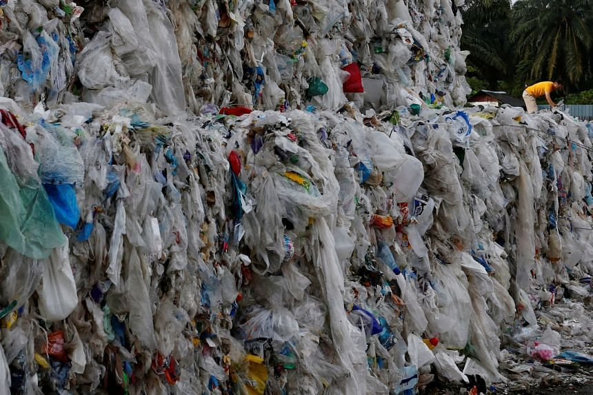 A 2018 photo shows plastic waste piled outside an illegal recycling factory in Jenjarom, Kuala Langat, Malaysia.
