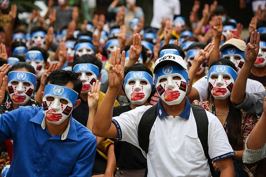Protesters doing the three-finger salute at a rally in Yangon on Sunday.