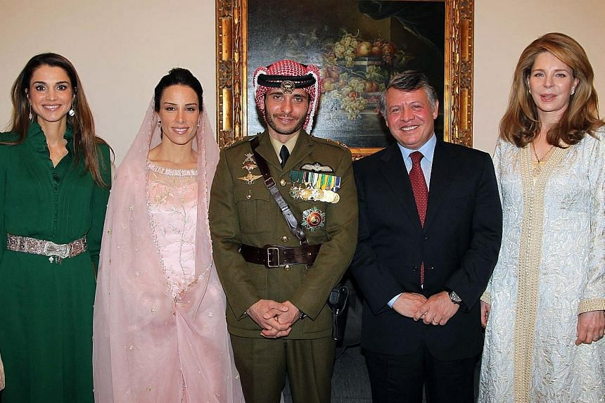 In this picture released by Jordanian news agency Petra in January 2012, King Abdullah (second from right) poses with (from left) his wife, Queen Rania; Princess Basma Otoum with her husband Prince Hamzah; and Queen Noor, widow of King Hussein. Princ