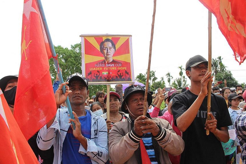 Protesters calling for the release of detained Myanmar civilian leader Aung San Suu Kyi during a demonstration against the military coup in Launglone township in Myanmar's Dawei district yesterday. Six people were killed at the weekend, according to