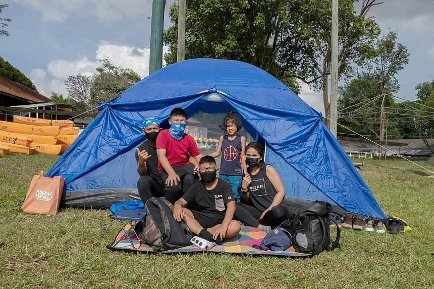 """Travel agency SGTrek conducts """"camp-cations"""" at a private campsite in Sembawang where participants can learn basic survival skills such as how to pitch a tent, cook in the outdoors and start a fire. Since campsites reopened this year, Mrs Dixie Chin"""