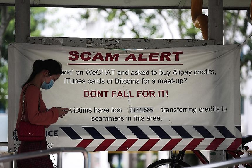 A scam alert banner in Clementi in June last year. E-commerce scams, social media impersonation scams, loan scams and banking-related phishing scams accounted for 68.1 per cent of the top 10 scams reported last year, said the police.