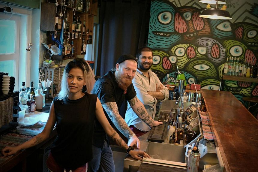 (From left) Entrepreneurs Desiree Jane Silva, Jay Gray and Abhishek Cherian George set up the Sago House cocktail bar in the midst of circuit breaker.