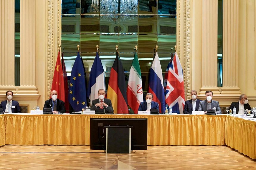 A handout photo shows diplomats of the EU, China, Russia and Iran at the start of talks at the Grand Hotel in Vienna on April 6, 2021.