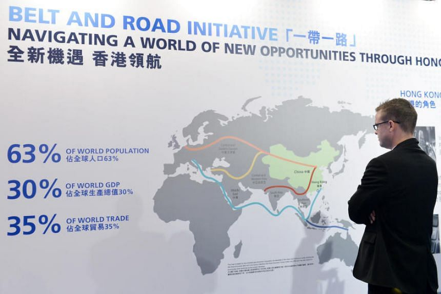 A visitor looking at the information board showing Hong Kong's participation in the Belt and Road Initiative.