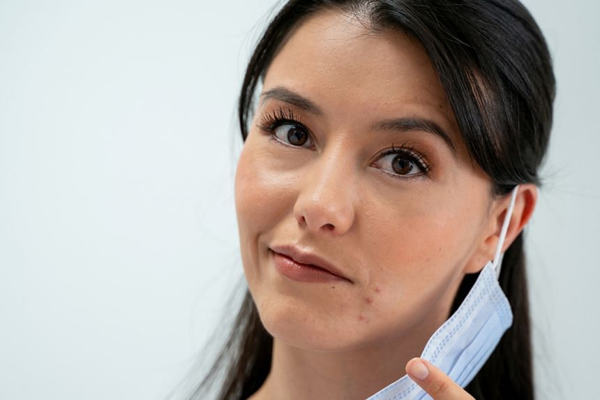 The retention of heat and humidity from perspiration and exhaled air within the mask may lead to acne.
