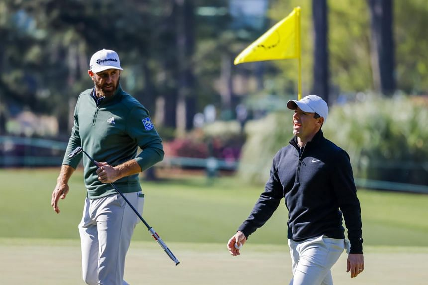 Dustin Johnson (left) and Rory McIlroy during a practice round for the Augusta National in Georgia on April 5, 2021.