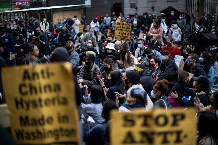 People are seen during a Stop Asian Hate rally in front of a building where an Asian woman was attacked, in New York City, on April 4, 2021.