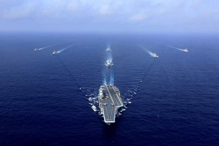 """China's navy said the carrier group, lead by the Liaoning, was carrying out """"routine"""" drills in the waters near Taiwan."""