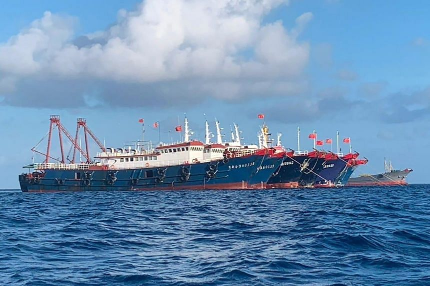 In a photo provided by Philippine Coast Guard, Chinese vessels are seen anchored at Whitsun Reef on March 27, 2021.