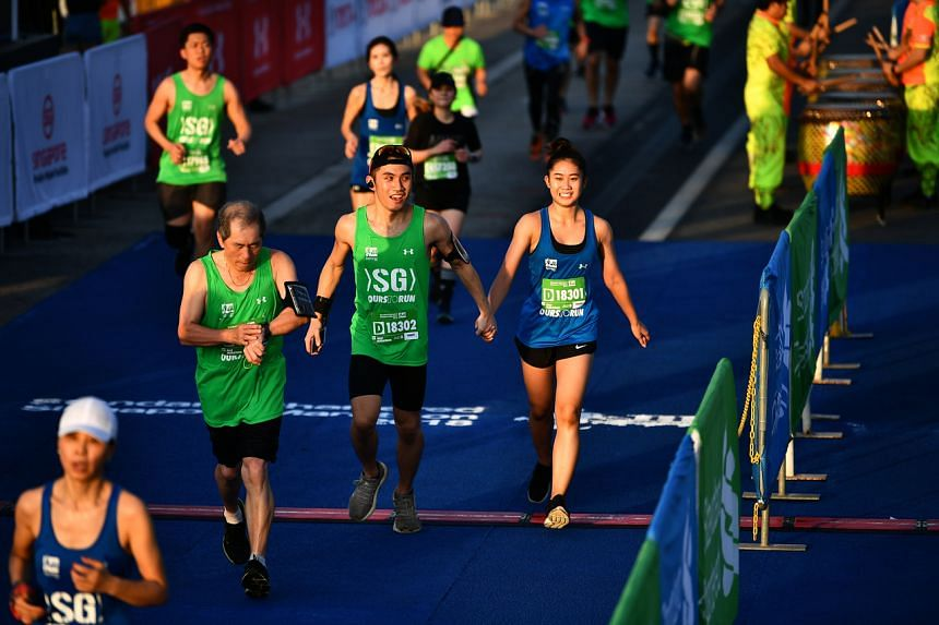 Runners at the Standard Chartered Singapore Marathon 2018. For events like mass runs, no more than 250 participants per session are allowed.