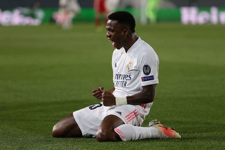 Real Madrid striker Vinicius Jr celebrates after scoring the 1-0 lead against Liverpool.