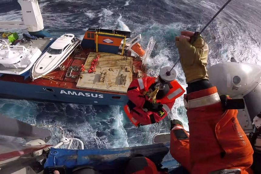 Head cam footage shows a crew member from the stricken ship being evacuated in stormy weather off the coast of Norway.