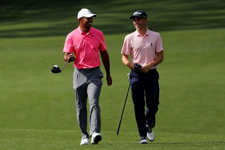 A 2018 photo shows Woods (left) and Thomas sharing a laugh during a Masters practice round in Augusta.