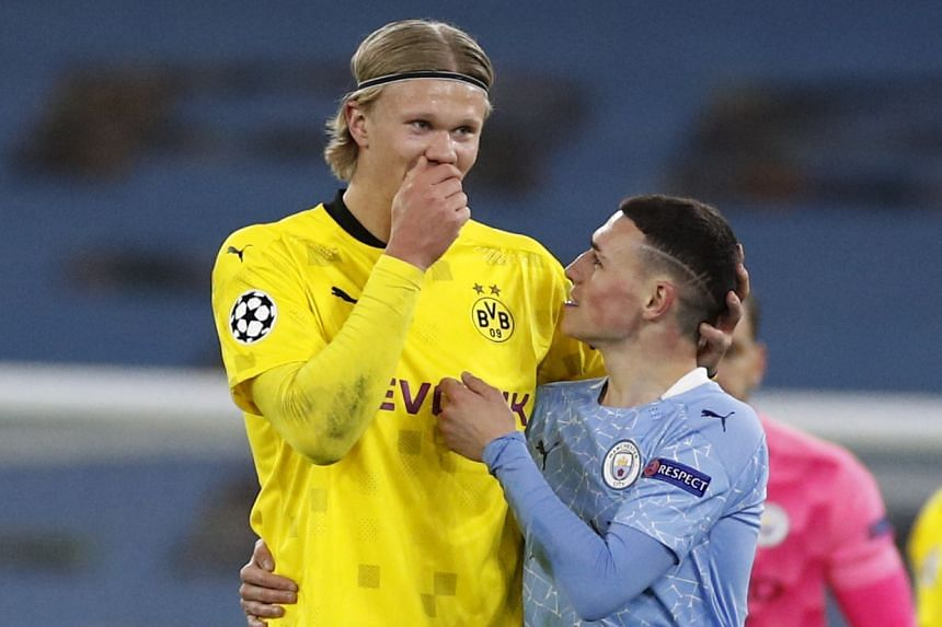 City's Phil Foden (right) with Borussia Dortmund's Erling Braut Haaland after the match.