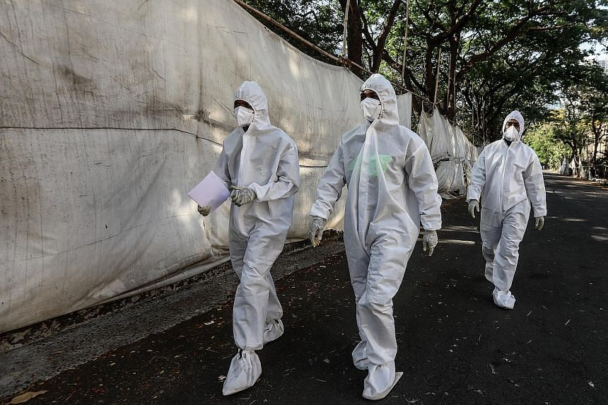 Health workers outside a quarantine centre in Mumbai, India, on Monday. The country is facing record-level infections.