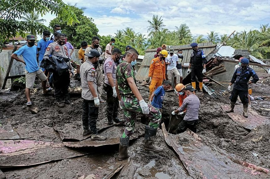 Rescuers searching for victims under the debris in a village in East Flores, Indonesia, yesterday after a flash flood hit the region on Sunday. Torrential rains from Tropical Cyclone Seroja caused floods and landslides that swept away villages in Ind