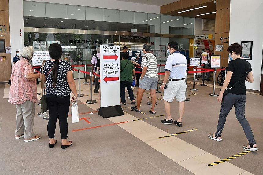 People entering Ang Mo Kio Polyclinic in January. Providing more health and social services goes beyond strengthening ministries or health departments, the writer says, adding that governments must change the way taxes are collected and distributed,