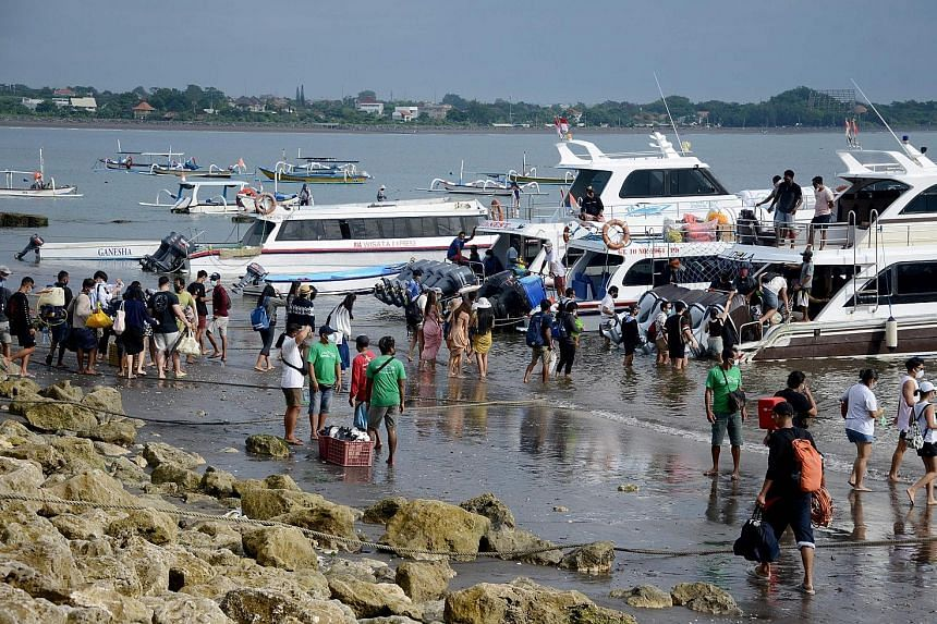 People preparing to board a fast boat from Sanur beach near Denpasar on the Indonesia resort island of Bali on Jan 7. Indonesian officials are in discussions with their counterparts in Singapore to allow limited travel to Indonesia.
