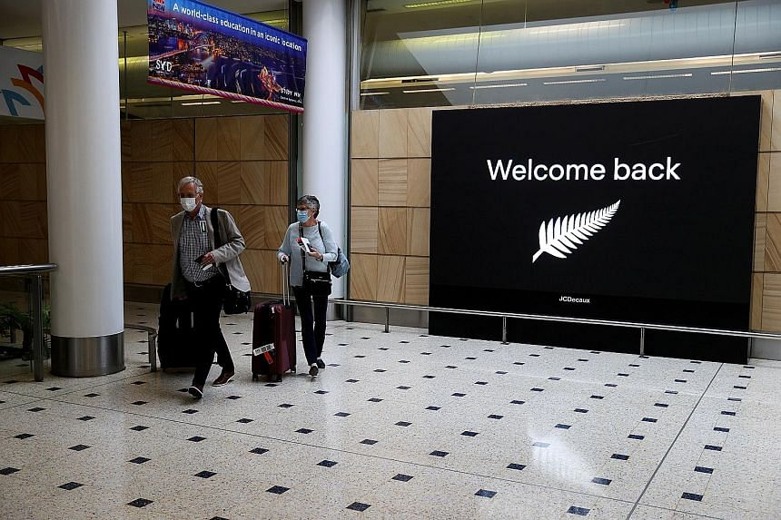 Passengers from New Zealand arriving at Sydney airport on Oct 16 last year. Australia has had a one-way travel bubble since October that allows people to enter from New Zealand without quarantining, though entry has been restricted several times foll
