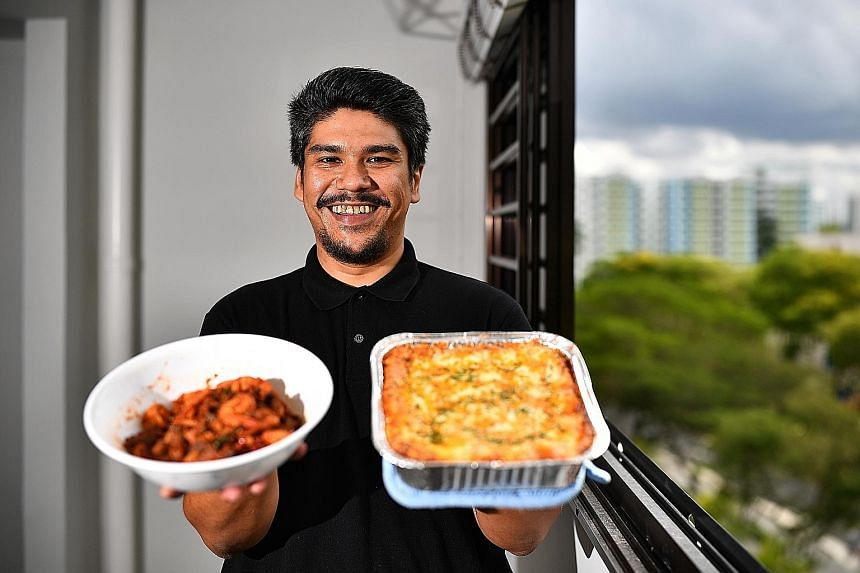 Mr Azlan Shah Rabel, founder of Foodprove, with his sambal goreng pengantin and lasagne - two of the dishes on the menu of his catering business.