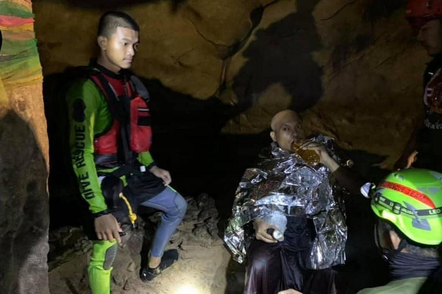 An unseasonal rainstorm flooded parts of the cave in Thailand's Phitsanulok province while the monk was inside.
