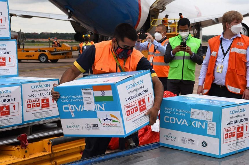 Boxes of Covaxin vaccines donated by India are unloaded at Silvio Pettirossi International Airport, in Luque, Paraguay, on March 29, 2021.