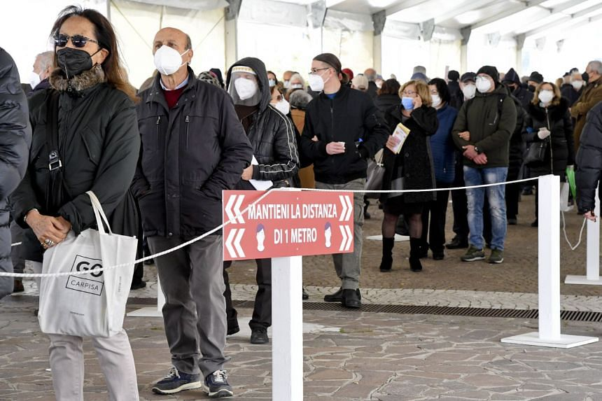 People wait in long lines to get vaccinated in Naples, Italy, on April 6, 2021.