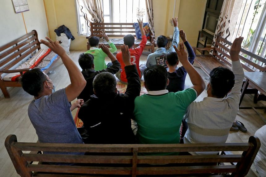 A March 2020 photo shows Myanmar nationals sheltering in India's Mizoram state flashing the three-finger salute in defiance of the coup leaders.