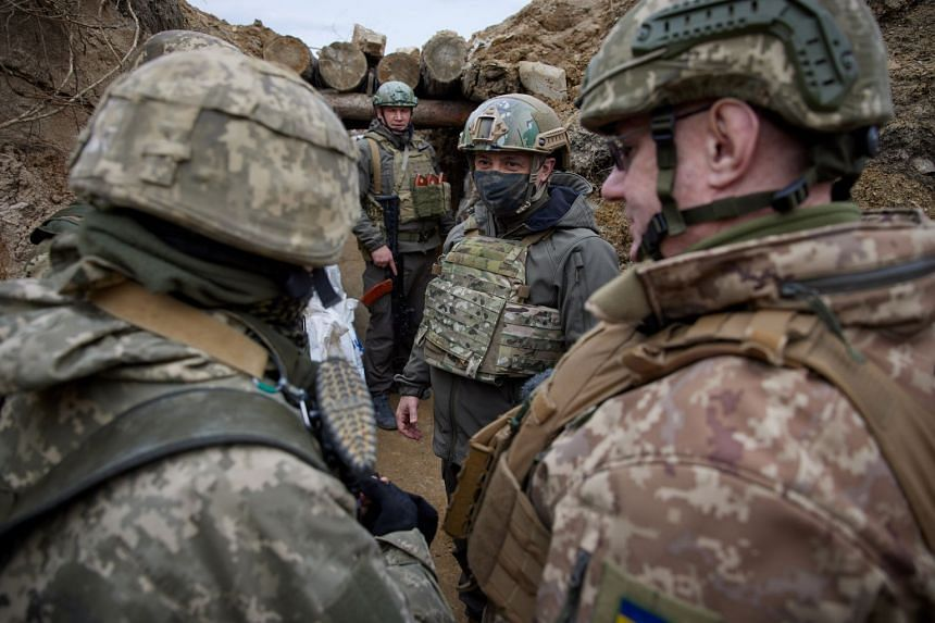 President Zelensky visits armed forces near the front line with Russian-backed separatists in Ukraine's Donbass region.