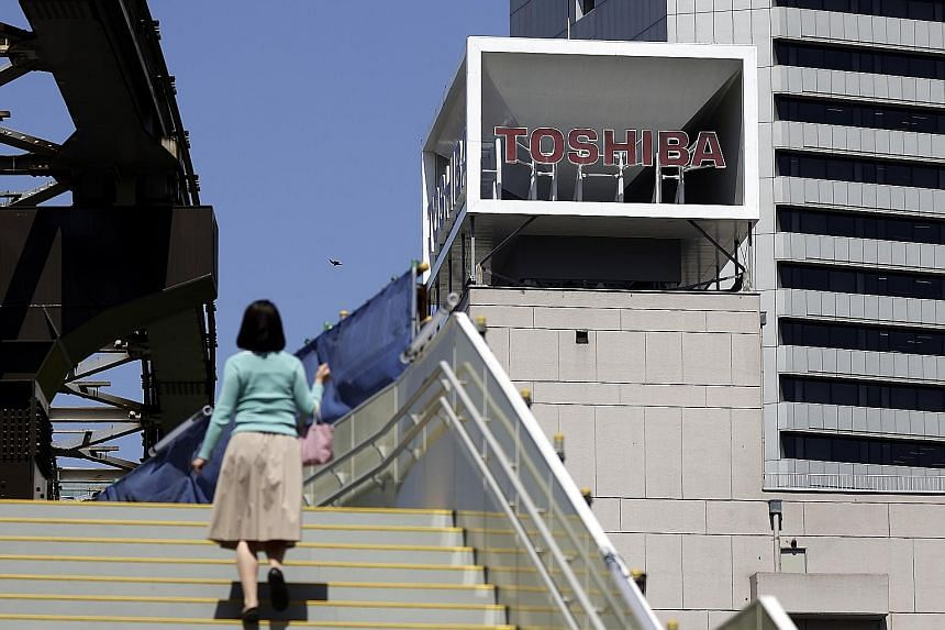 Shares in Toshiba soared 18 per cent to their daily limit yesterday, after news that the Japanese industrial group had received a proposal from private equity firm CVC Capital Partners to take it private.