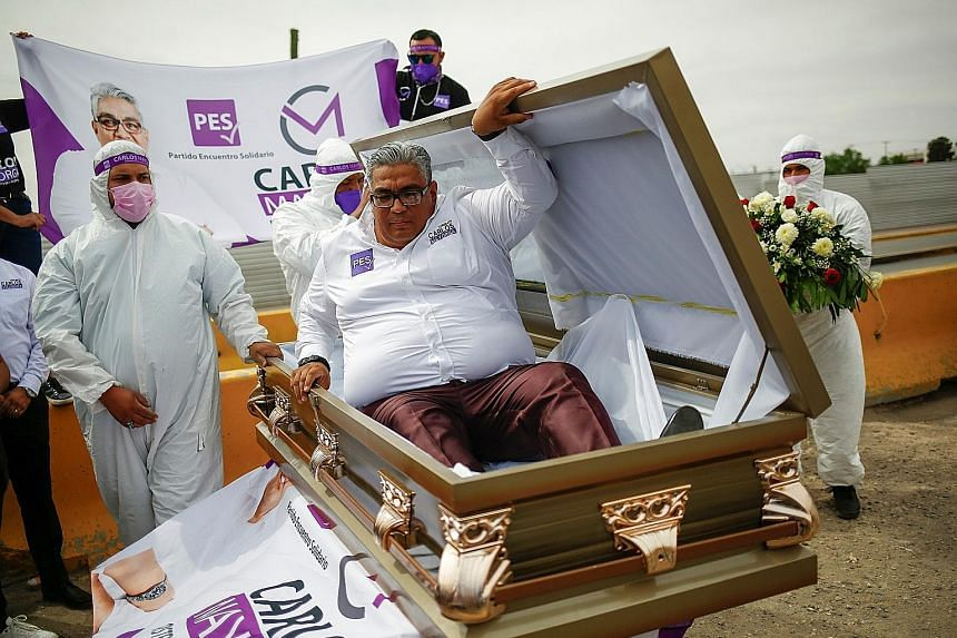"""Mr Carlos Mayorga emerging from a coffin on Tuesday as part of his election campaign slogan """"If I don't deliver, let them bury me alive"""". He is a Lower House candidate for the Encuentro Solidario party in the northern state of Chihuahua, Mexico."""