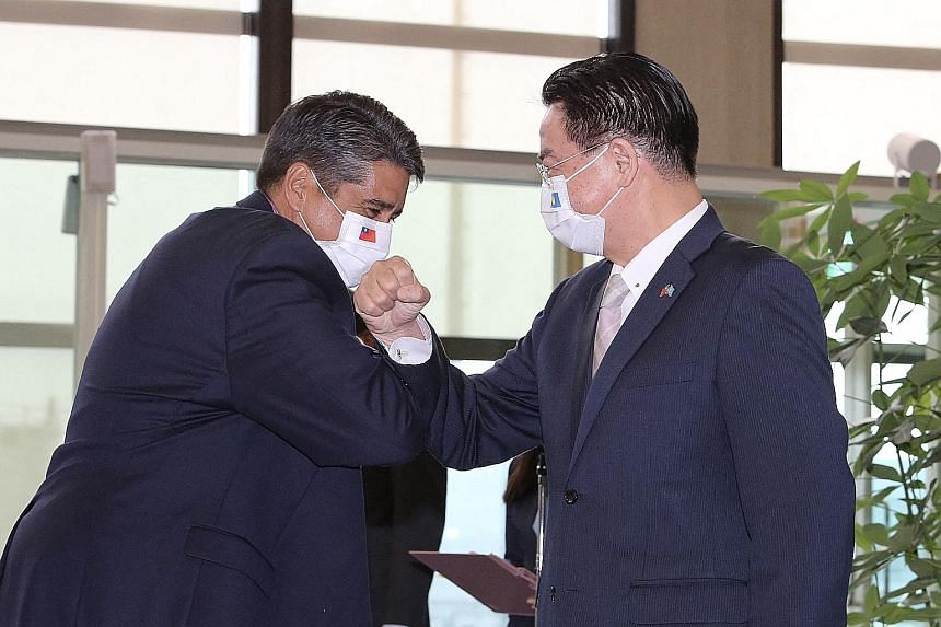 Palau's President Surangel Whipps Jr (left) bumping elbows with Taiwan's Foreign Minister Joseph Wu at Taoyuan International Airport in Taipei last month. The Pacific nation of around 21,000 people is one of 15 countries that still recognise Taiwan o