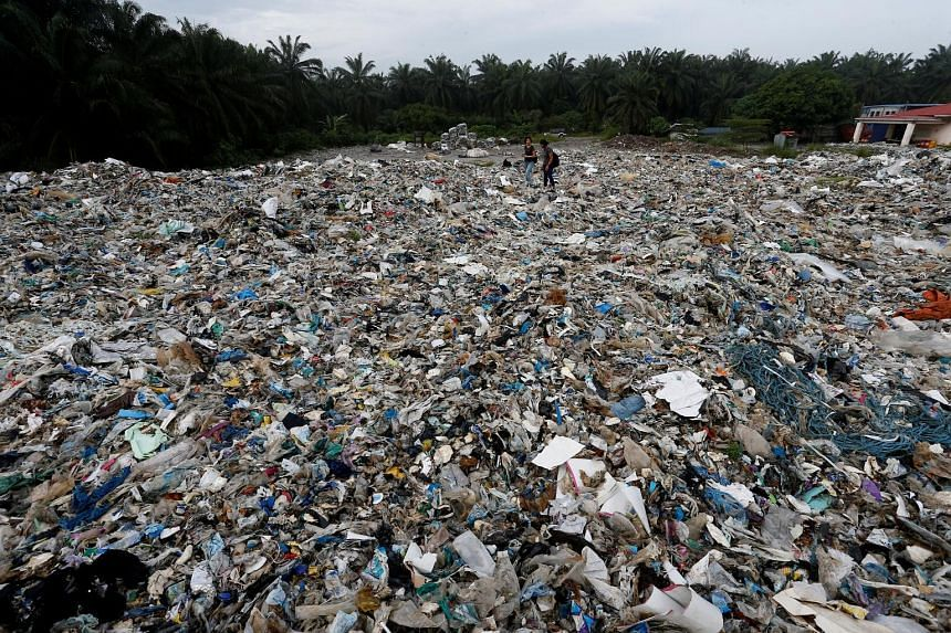 Plastic waste piled outside an illegal recycling factory in Jenjarom, Selangor, in 2018. Malaysia became the destination of choice for the world's plastic waste after China banned such imports in 2018 and it is now struggling with a deluge of general