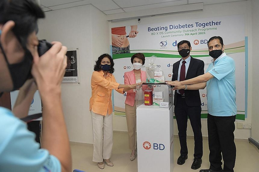 At yesterday's launch of the Community Outreach Programme were (from left): Dr Kalpana Bhaskaran, president of Diabetes Singapore; Mayor Low Yen Ling; Becton, Dickinson and Company's executive vice-president and president of Greater Asia James Lim; a