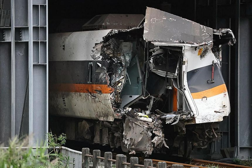 A damaged train carriage extracted on Tuesday from the site of the deadly derailment north of Hualien, Taiwan. The train crash near the famous Taroko Gorge last Friday killed at least 50 and injured 218. The Taiwan Railways Administration yesterday s