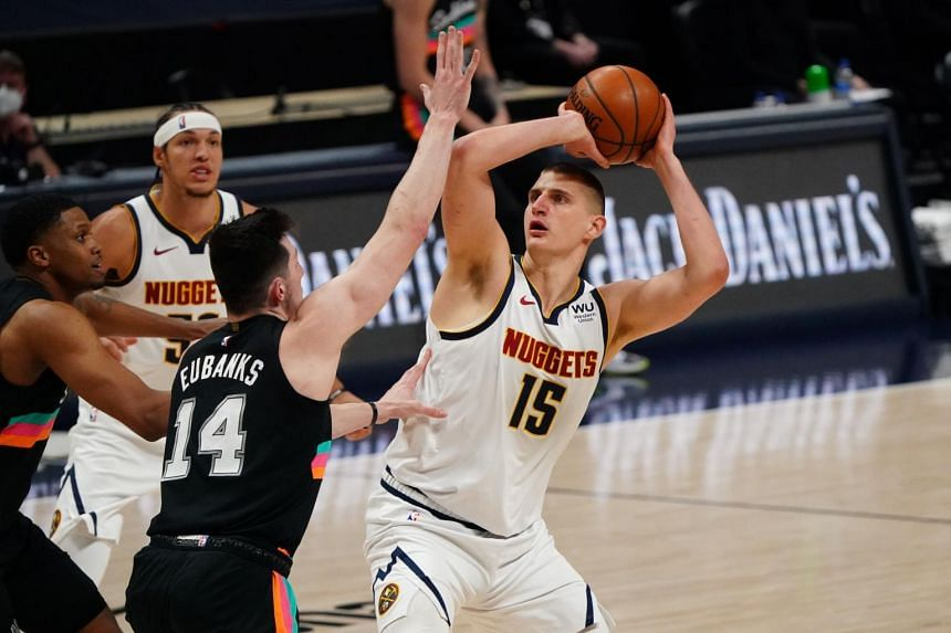 Denver Nuggets centre Nikola Jokic (15) looks to shoot the ball over San Antonio Spurs forward Drew Eubanks (14) on April 7, 2021.