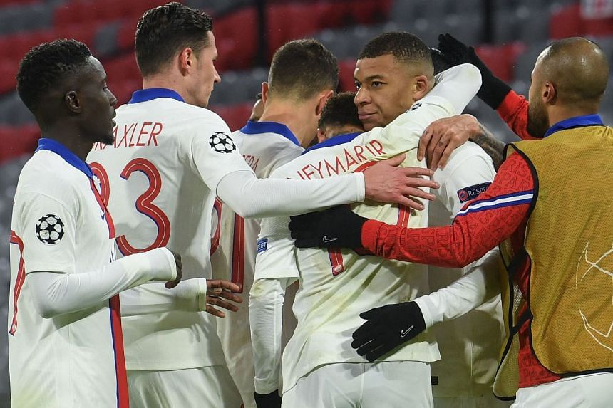 Mbappe (second from right) celebrates scoring the third goal for PSG.