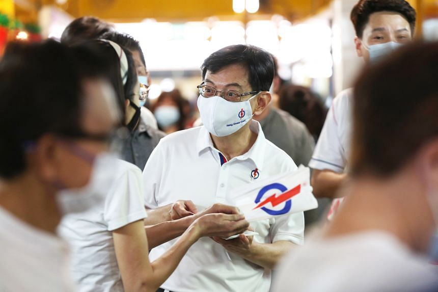 A file photo from July 5, 2020, showing Deputy Prime Minister Heng Swee Keat interacting with residents during a walkabout at Bedok South Market and Food Centre.
